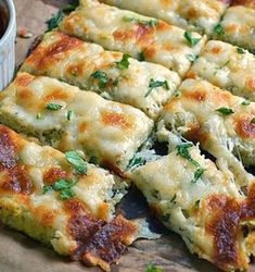 Low Carb Cauliflower Breadsticks with fresh herbs, garlic, and lots of ooey gooey cheese atop a cauliflower crust looks and tastes like cheesy bread! One of my favoite low carb recipes! Cauliflower Breadsticks, Cheesy Cauliflower, Cauliflower Crust, Breadsticks Recipe, Garlic Breadsticks, Cauliflower Recipes, Califlower Garlic Bread, Cauliflower Cheese Sticks, Cauliflower Casserole