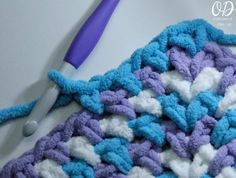 Soft and squishy - this yarn does make the perfect baby blanket. Zoey's Baby Blanket is a Square Crocheted Baby Blanket. It can be completed in as little as 8 hours if you need a project you can sit down and make today for a gift tomorrow. Quick Crochet, Crochet Bebe, Chunky Crochet, Crochet Baby Booties, Crochet Yarn, Beginner Crochet, Crochet Flowers, Crochet For Beginners Blanket, Crochet Blanket Patterns