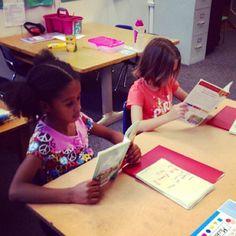 Girls reading new books from Reading Is Fundamental,  our National Philanthropic Partner. #KKG #KKG1870