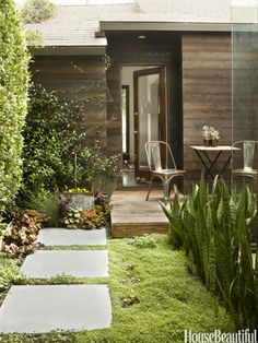 low-maintenance garden... baby tears ground cover, small deck, large pavers... from Modern House Decorating Ideas - Small House Interior Design Ideas - House Beautiful