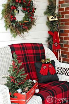 Festive front porch - love the plaid throw. ~ 50 Stunning Christmas Porch Ideas - Cute Christmas Entry Vignette - Christmas Decorating - Style Estate -
