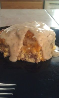 "Sausage and biscuit casserole with gravy. Our new favorite breakfast casserole, used frozen baking powder biscuits (baked) instead of the ""tube"" rolls. Gravy is delish."
