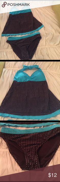 Bathing Suit Tankini. Turquoise and chocolate brown tankini bathing suit. Ties at neck. Bottom of top has a very slight ruffle of the turquoise and white material. It says it is a size medium. Probably I would compare to a size 8.  Never worn. 24th & Ocean Swim Bikinis