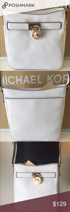 🆕MICHAEL KORS NEW CROSSBODY 💯AUTHENTIC MICHAEL KORS NEW NEVER USED WITH TAGS WHITE PEBBLE LEATHER CROSSBODY BAG 100% AUTHENTIC. SO STUNNING AND STYLISH . SUCH A BEAUTIFUL BAG. JUST LOVELY! IT HAS A GREAT REAR BACK POCKET. THE BAG HAS A ZIP TOP AND AND IT HAS A AMAZING FIVE INTERIOR WALL POCKETS! TRULY A WONDERFUL BAG. THE BAG MEASURES 8 INCHES WIDE BY NEARLY 9 INCHES TALL. IT ALSO HAS A LONG ADJUSTABLE SHOULDER/ CROSSBODY STRAP Michael Kors Bags Crossbody Bags