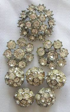 vintage rhinestone buttons and jewelry add sparkle to a tree, garland or ornaments