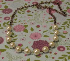 Upcycled vintage pearl beads on a bronze chain.    $30