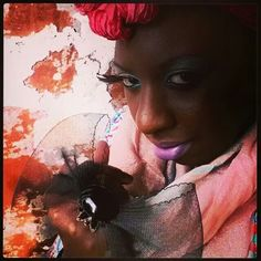 Merazh Roberts owner of Merazh Beauty Boutique rockin her signature street style Feather eyelashes scarves and a beautiful Bow ring by Designer Nailah Lymus♥♥♥