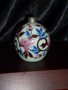 Harrach Uranium Glass perfume. Elaborate enamel of flowers and leaves