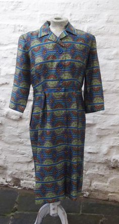 "1970s Mandela pattern psychedelic dress.     Chest: 38""    Length: 33""    Arm length: 17""    Modern size: 14"