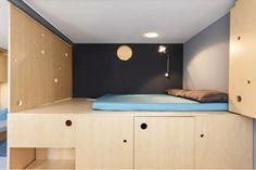 This lofted bed makes it possible to add extra storage to the apartment, but with this design, they are able to lift it up to reveal a wardrobe underneath.