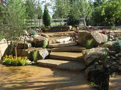 Landscaping Steps Pictures | Rustic Flagstone Patio with Slab Stairs and Large Boulders in Arvada