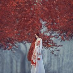 Oleg Oprisco. The contrast of the gray and the orange emphasizes on the woman centered in the middle of the photograph.