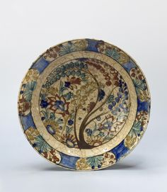 Name:  Dish  Place of creation: Iran  Date: 17th century  Material: faience  Technique:  polychrome painting  Dimension:  diam. 33 cm