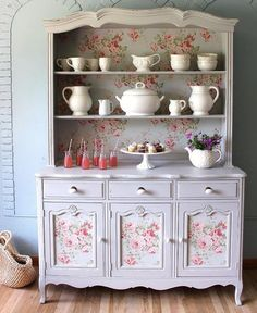 Beautiful hutch china cabinet restored by me. Painted with a light grey color and a light blue floral background, it will give you an interesting