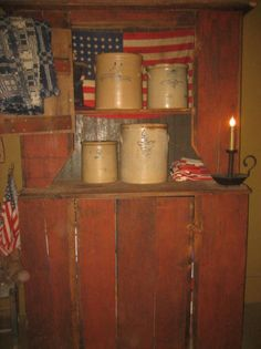 Primitive Red Cupboard...filled with old crocks & flags.