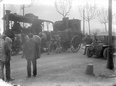 Steam tractor, heavy horse car and automobile in Barcelona