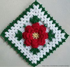 Crochet Knitting Handicraft: Granny's square with a flower.