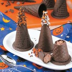 Mousse-Filled Witches' Hats  - Cute chocolate-covered treats will magically disappear at your house - Click Pic for Recipe -  #halloween #recipes