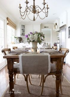 romantic spring table in white farmhouse kitchen french country chandelier purple and white flowers White Farmhouse Kitchens, Country Farmhouse Decor, French Country Decorating, Country Kitchen, French Kitchen, French Farmhouse, French Country Chandelier, Kitchen Chandelier, Chandelier Ideas