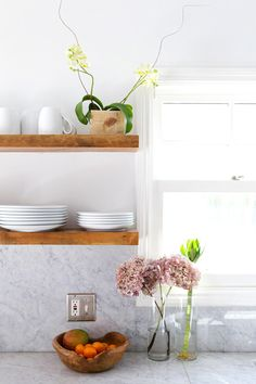 marble counters with floating wood shelves. at home in silverlake / sfgirlbybay Kitchen And Bath, New Kitchen, Kitchen Dining, Kitchen Shelves, Wood Shelves, Open Shelves, Floating Shelves, Home Decoracion, Kitchen Interior