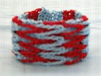 Interlocking Loops Bracelet - take a different yarn and different colors, then it could look really stylish