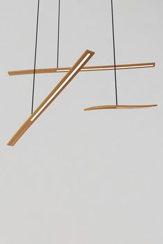 The balance pendant is a thin steam bent timber LED light that can work alone as a task light or in a cluster as feature lighting. The sliding counterweight allows the  user to set light to desired angle. Available in American Oak, Spotted Gum or Black Walnut.        Designed by Viktor Legin