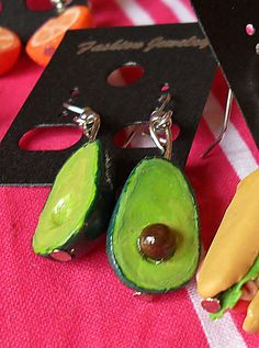 Avocado half earrings. Handmade by me from polymer clay. Deliciously guilt-free