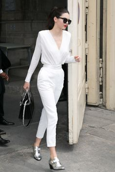 Leaving the Chanel show in Paris, she keeps things fresh in a white jumpsuit and the same silver brogue boots she wore the day before. - MarieClaire.com