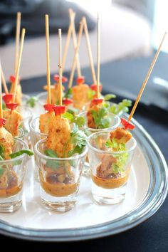 Chicken satay appetizers served in a shot glass #appetizers #hosdoeuvres #entertaining #catering: