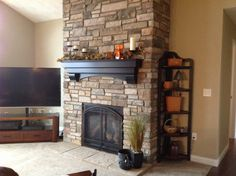 Here is a fireplace we recently installed in a customer's new home. The products shown are the Heat-n-Glo 6000CLX gas fireplace, Boral's Chardonnay Country Ledgestone cultured stone, and our very own Auburn mantel that we make in our very own woodworking shop. It looks great!