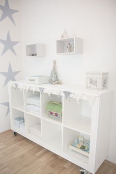 IKEA HACKS -Shabby EXPEDIT. Cover the sides and top with rough planks, add casters  and  paint the whole thing white.