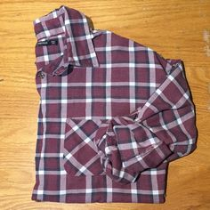 """Brandy Melville Plaid Shirt Womens fit plaid shirt from Brandy Melville USA. A pinkish-burgundy, navy & white plaid that's a perfect pairing piece under a sweater or vest! Comes in """"one size"""" according to the tag but would say it fits like a medium. I am 5'9"""" (typically a medium) and it just covers my bum. Great condition--only worn a handful of time. Brandy Melville Tops Button Down Shirts"""