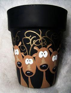"""flower pots outdoor This beautiful hand painted terracotta pot that is painted with cute little Reindeer. I call this """"Reindeer in Headlights"""". The reindeer are painted chocolate b Flower Pot Crafts, Clay Pot Crafts, Christmas Projects, Holiday Crafts, Noel Christmas, All Things Christmas, Winter Christmas, Christmas Ornaments, Painted Flower Pots"""