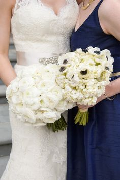 Bridesmaids bouquet designed with white hydrangea and accented with white anemone. Arranged by Phillip's Flower. Photography by Averyhouse.