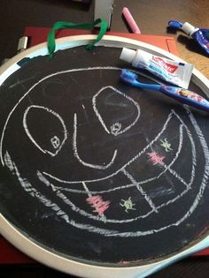 CHALK TEETH BRUSHING - A fun way to teach children about the value of teeth brushing :) This chalk picture has food and germs all over the chalk teeth and children are then encouraged to brush them away.