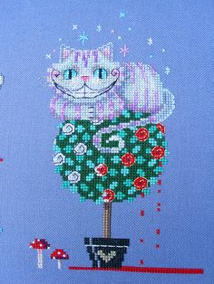 Brooke's Books Wonderland Cheshire Cat Cross by BrookesBooksStore