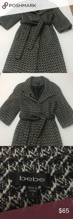 Bebe houndstooth black cream and silver Bebe brand black cream and silver sparkle throughout this gorgeous classy coat. Unique look as it has 3/4 length sleeves. It's a timeless addition to any wardrobe.very gently used. bebe Jackets & Coats