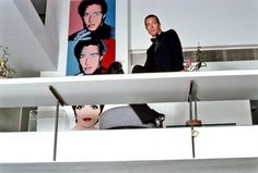 Halston in his Paul Rudolph designed townhouse with three Warhol portraits.