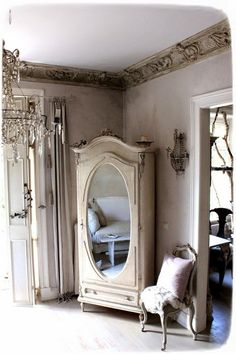 I Love the Soft Grey Wall with a Hint of Lavender in this Beautiful Shabby French Space! See More at thefrenchinspiredroom.com