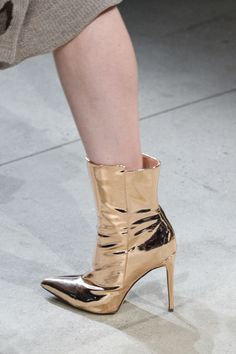 Golden ankle boots that can slay any outfit!