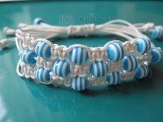 Variation of 3 strand shamballa - tutorial in Russian, but video gives clear directions