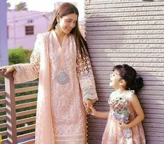Image may contain: 2 people, people standing Pakistani Fashion Party Wear, Pakistani Dress Design, Pakistani Outfits, Indian Fashion, Mother Daughter Dresses Matching, Mother Daughter Fashion, Mother Daughters, Mom Daughter, Eid Dresses