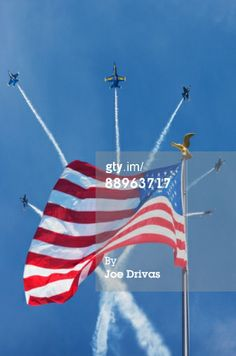 Blue Angels flying behind the American flag with golden eagle