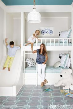 Homeowner Amy Wacaster in the bunk room with her kids, Harris and Gigi; the beds and slide are custom, and the flooring is engineered wood tile from Mirth Studio.