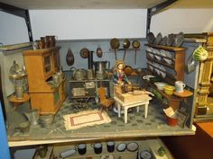 German dollhouse kitchen, ca.1890.  Size: 67 x 40 x 33 cm.  Old floor and wall painting, furnished with shelves and oven, and many accessories of copper, brass, tin and porcelain.
