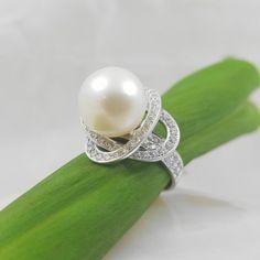 18k witgouden ring met echte parel en voor 1ct diamanten