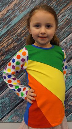PDF pattern from SUAT. Three sleeve lengths with the option to hem or finish with a cuff plus a sleeveless option. Make your shirt unique with the color blocked front. This pattern has clear photos and detailed instructions, perfect for beginners and more experienced sewers alike. It is designed for knit fabrics and requires less than 1 yard of fabric for all sizes. Please check the pattern cover in the photos for specific sizing and fabric requirements. www.stitchuponatime.com