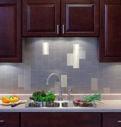 kitchen tile designs. tin tiles for backsplash  Aspect peel and stick metal from backsplashideas com Bronze white cabinets rubbed bronze hardware