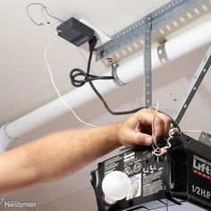Whether your garage door won't open or the sensor isn't working, learn about how to troubleshoot and repair the garage door opener with these models and steps. Garage Door Keypad, Garage Door Sensor, Garage Door Lights, Garage Door Remote Control, Best Garage Doors, Dream Garage, Garage Door Motor, Electric Garage Door Opener, Garage Door Opener Repair