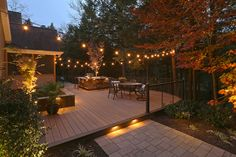 The homeowners wanted an integrated, open outdoor space for entertainment and grilling. It had to look great from the inside of their home and offer the feel of a private wooded retreat; yet be functional. #designbuild #landscapelighting #backyard_retreat #outdoor_kitchen